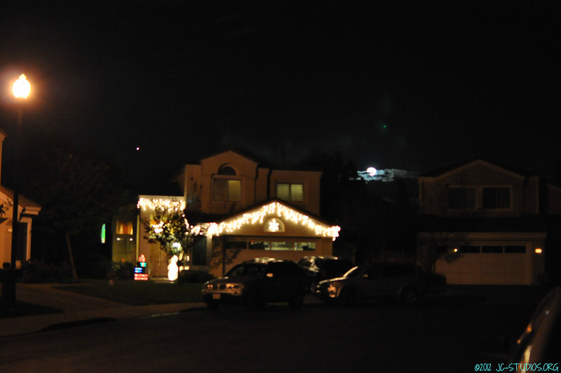 12/31/2012 - Low hanging moon behind my neighbor's house. Happy New Year everyone!!!