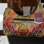 This Anuschka shoulder bag was a silent auction item.