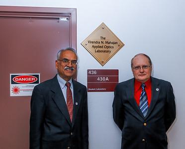 Vini Mahajan and Jim Wyant outside the Virendra N. Mahajan Applied Optics Laboratory