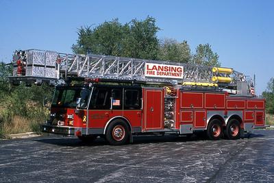 LANSING FD  TOWER 107  1990  E-ONE HUSH   1500-200-95'   #7530   GARY KADZ PHOTO