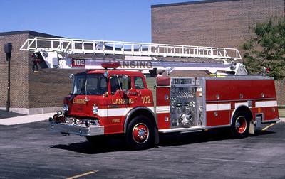 LANSING FD  ENGINE 102  1990  FORD C - KME   1250-500-50' TSQT   #1015    GARY KADZ PHOTO
