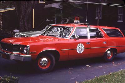 BATAVIA FD NY  CAR 201  1976  RAMBLER   FIRE CHIEF     LEO DULIBA PHOTO