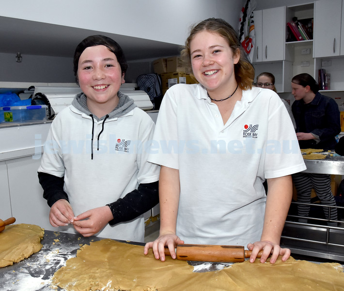 JEMS honey biscuit bake at OBK. Raffy Linzbichler (left), Carlie Kelly. Pic Noel Kessel