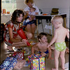 5. By his second birthday, he had this party thing down pretty good. That was baby Emily Jaynes in her mother's lap at back.