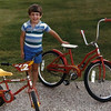 8. I think this was the year he moved up from a little bike to a used, girl's bike.