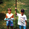 1. Not sure where are our birthday party pictures of his 9th birthday, but i think this comes from at event. With neighbor Brian Haas. And Richard Petty's car, which usually got blown up with fireworks in subsequent years. Marks are visible on the pole.