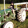7. After we got back home to Greeneville, we drove up to Fall Branch to see Meme and Granddad. This may have been Jeremiah's first chance to drive the tractor.