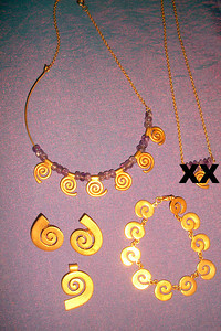 SPIRAL THINGS: Spiral slide = $35 Spiral clip-on earrings = $35 Amethyst & gold-toned Spiral Jewels. Spiral bracelet (Smaller) = $60 Spiral & Amethyst Necklace (Larger/6 spirals) = $80 (a popular Costa Rican Antiquity design)  REDUCED!! ALL 4 pieces (minus the small necklace pictured): $180-FIRM   @@@@@@@@@@@@@   MORE SPIRAL THINGS: Never worn - Spiral Copper necklace & pierced dangling earrings REDUCED:  $20 (all 3 pieces)   Purple Spiral Writing PEN, thick, barely used! Want to impress??? This definetly has the COOL factor!  REDUCED:  $15   TAKE IT ALL for just $200!!!    See other things for sale at: http://Things4SaleCostaRica.com   1-941-312-7569  •  SarongGoddess@gmail.com