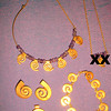 """SPIRAL THINGS:<br /> Spiral slide = $35<br /> Spiral clip-on earrings = $35<br /> Amethyst & gold-toned Spiral Jewels.<br /> Spiral bracelet (Smaller) = $60<br /> Spiral & Amethyst Necklace (Larger/6 spirals) = $80<br /> (a popular Costa Rican Antiquity design)<br /> <br /> REDUCED!! ALL 4 pieces (minus the small necklace pictured): $180-FIRM<br /> <br /> <br /> @@@@@@@@@@@@@<br /> <br /> <br /> MORE SPIRAL THINGS:<br /> Never worn - Spiral Copper necklace & pierced dangling earrings<br /> REDUCED:  $20 (all 3 pieces)<br /> <br /> <br /> Purple Spiral Writing PEN, thick, barely used! Want to impress??? This definetly has the COOL factor!<br /> <br /> REDUCED:  $15<br /> <br /> <br /> TAKE IT ALL for just $200!!!  <br /> <br /> See other things for sale at:<br />  <a href=""""http://Things4SaleCostaRica.com"""">http://Things4SaleCostaRica.com</a><br /> <br /> <br /> 1-941-312-7569  •  SarongGoddess@gmail.com"""