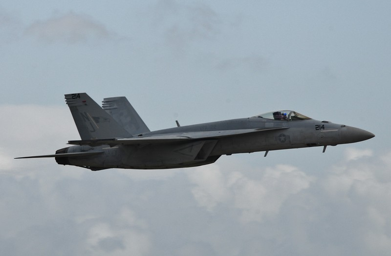 The F-18 makes a pass in front of show center and only a few from above the ground.