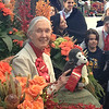 Dr. Goodall in her Grand Marshal Rose Parade carriage. Youth leaders from Jane Goodall's Roots & Shoots, Maddie M., and Bryce M., are pictured in the background.