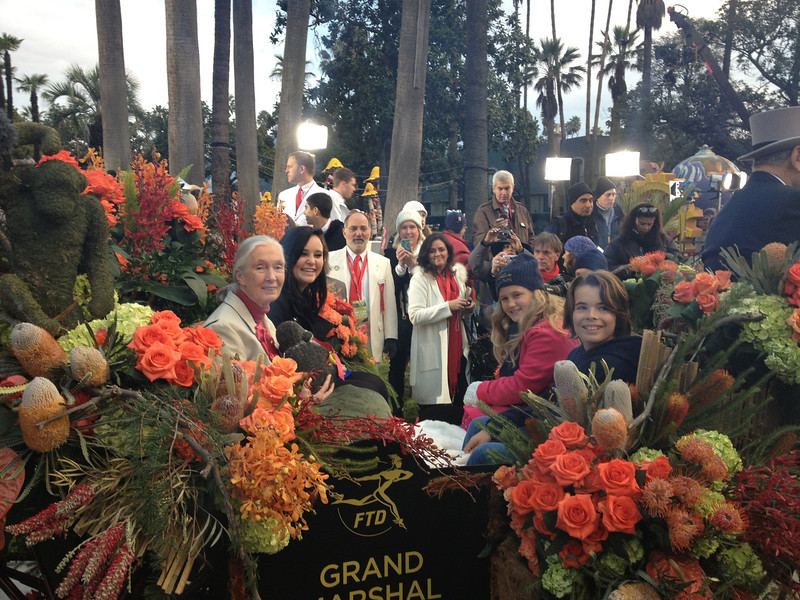 Dr. Goodall and three students from Jane Goodall's Roots & Shoots in a carriage for the Rose Parade.
