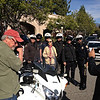 Dr. Goodall poses for a picture with her police escort at the Tournament of Roses festivities in Pasadena.