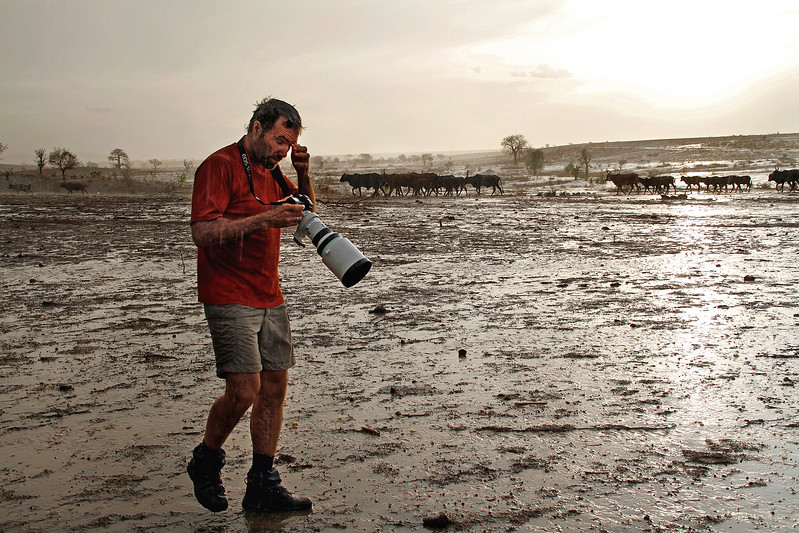 Photographer in a wet desert, just after sandstorm and rain.
