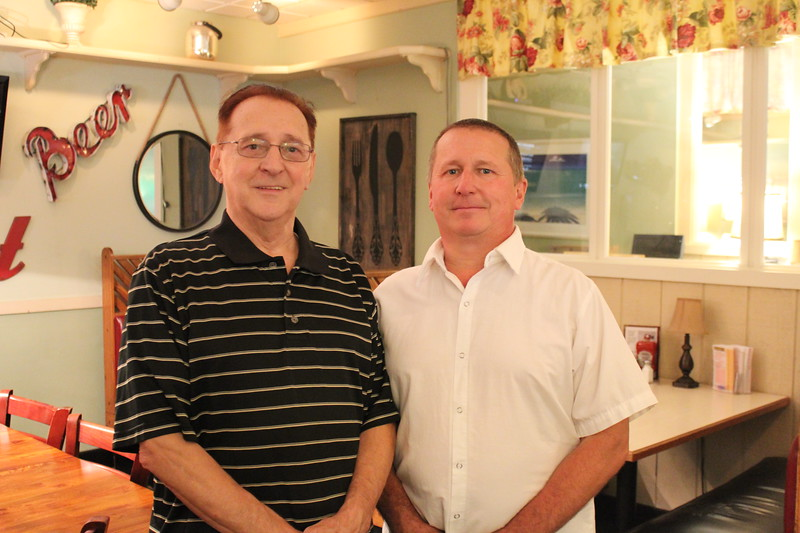 James C. Watson (left) and his son, James E. Watson, run sports bar J.J. Boomers on Pawtucket Boulevard. SUN/Nicole DeFeudis