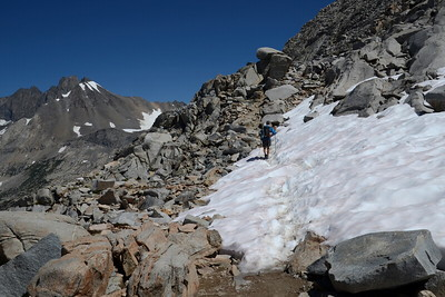 An unknown hiker heading down Mather Pass.