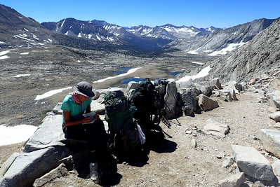 Jill catching up on her journaling on top of Mather Pass. Photo by Chuck Haak.