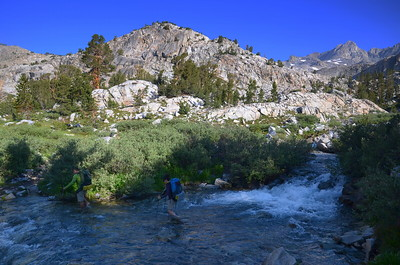 "These folks did a ""boots off' crossing of the Middle Fork Kings River not too far past Starr Camp. We didn't relish the idea of such an early wet crossing, so we scouted upstream and we found a nice spot where we could hop across on rocks. Score!!"