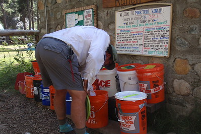Chuck pawing through the hiker buckets. He was delighted to find a whole block of Kerrygold Cheddar Cheese in one of them. Score! Photo by Jill Haak.