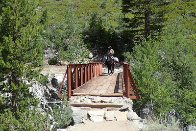Horse packer coming across another bridge. Chuck and Jill had a long conversation with this guy. He was packing in provisions to people who were planning on camping at Evolution Lake where we had camped the night before. Photo by Chuck Haak.