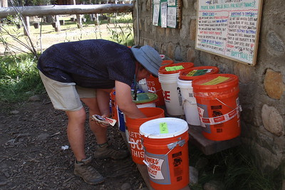 Me pawing through the hiker buckets. JMT and PCT hikers use these buckets to get rid of unwanted food items and/or to pick up something that someone else has left. We did both. Photo by Jill Haak.