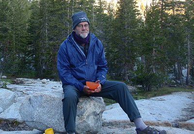 Chuck is looking forward to a day of hiking with newly-glued hiking shoes. Photo by Jill Haak.