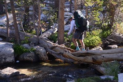 Chuck crossing a tributary of Bear Creek.