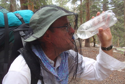 Chuck demonstrating the art of hydrating without removing one's headnet. Photo by Jill Haak.