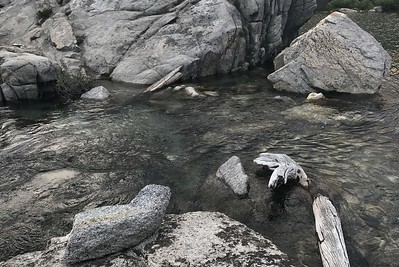 """The short stream connecting Upper and Middle Rae Lakes. It should have been a """"boots off"""" crossing but since my boots were already wet from slogging through the previous stream, I just slogged through this one as well."""