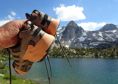 Chuck's relatively new boots started falling apart not long after we started our hike. He patched them up with Leukotape and prayed that they would survive the trip. Photo by Chuck Haak.