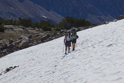 Chuck and Jill coming across a snowfield in the basin below Pinchot Pass.