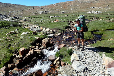 Jill at a small creek crossing below Pinchot Pass. Photo by Chuck Haak.