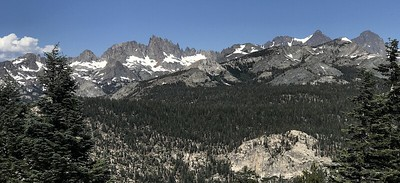 The view of the Ritter Range from Minaret Vista. The jagged ridge left of center is called The Minarets, and Mount Ritter and Banner Peak are on the right.
