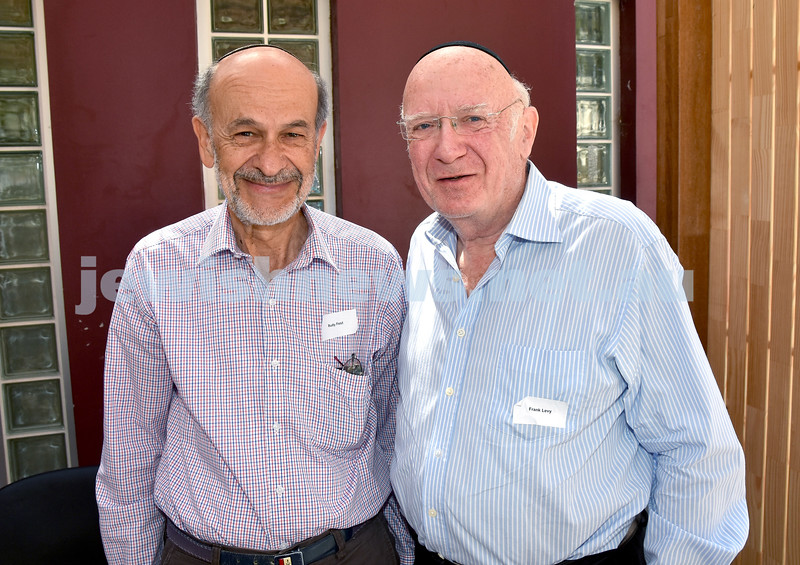 JNF Seniors morning tea in the Mizrachi Synagogue Succah. Rudy Fest (left), Frank Levy. Pic Noel Kessel