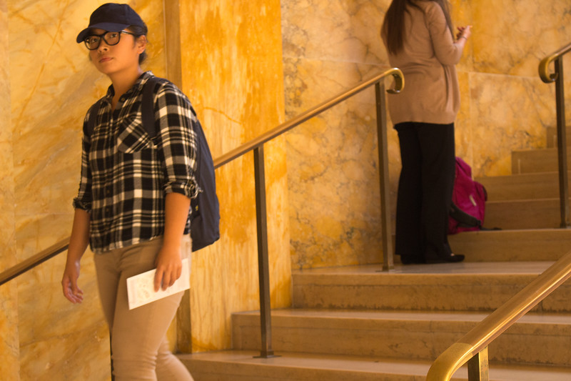 Portrait of a young student departing Boston Public Library. Picture taken on September 26, 2017.