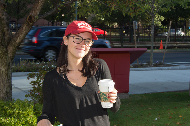 Rachel Kelly enjoying a cup of coffee on Boston University's COM lawn on October 3rd.