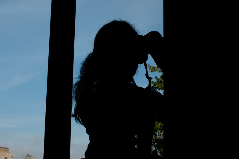 Silhouette of Hannalea Resnik inside the COM building. Photo taken for a COM JO 303 workshop.