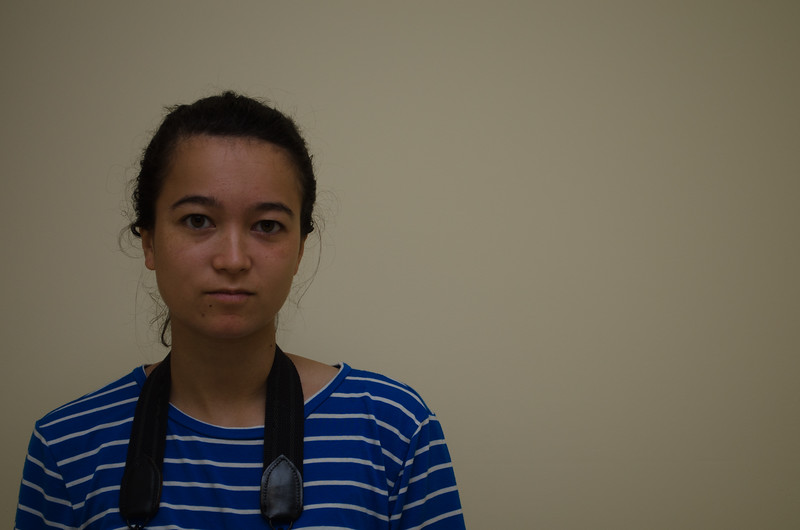 Erica Huang inside of Boston University's College of Communication during a flash photography workshop