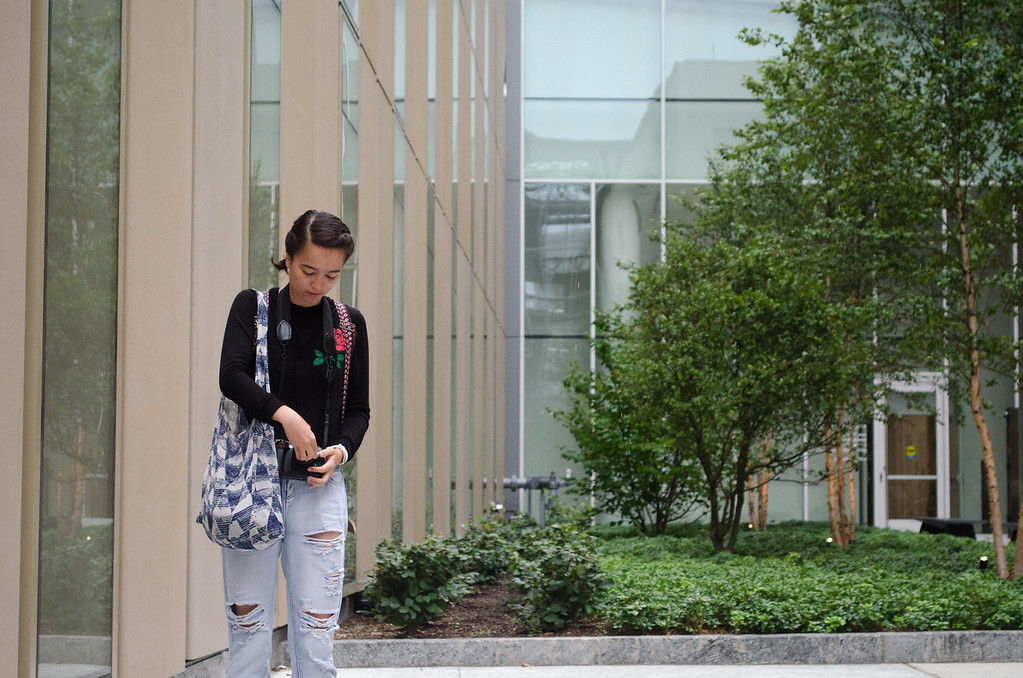 Erica Huang outside of Boston University's CILSE building during a photo workshop