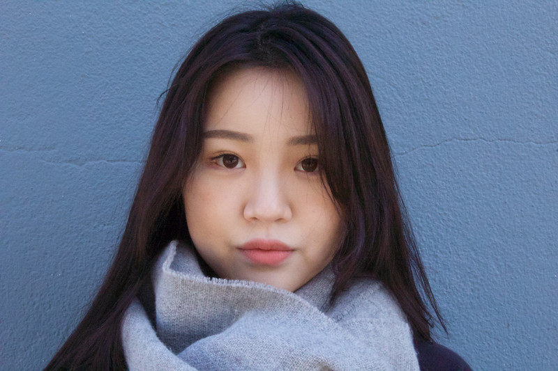 Shinhee Kim, Public Relations major stands in the shade on January 31.