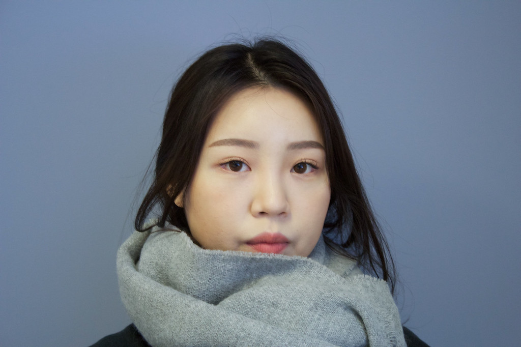 Shinhee Kim, Public Relations Major poses for the photo indoors in a COM classroom before class on January 31.