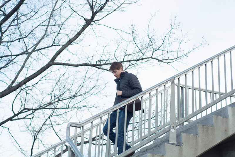 Griffin Salmon, psychology major at Boston University, photographed descending a Bay State brownstone staircase. February 13, 2018.