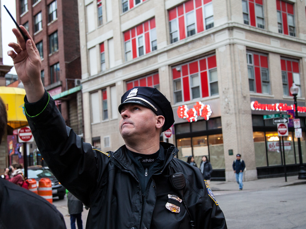 BOSTON, March 23, 2016 - A Boston Police officer who patrols Chinatown explains how highrise buildings have recently been built in the neighborhood. Photo by Alexandra Wimley