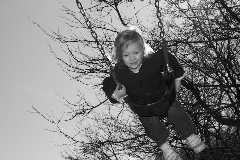 Avery Place swings at the playground near her house in Newton.  Photographed for Meredith Sorensen's fill flash assignment.