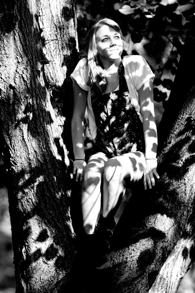 Olivia Klnkowski gazing in a spotted tree in the Thatcher Street Park in Boston, MA.