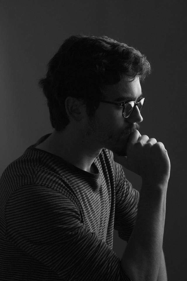Conrad Golovac posing in Peter Smith's studio in Boston, MA. Photo by: Sam Sarkisian