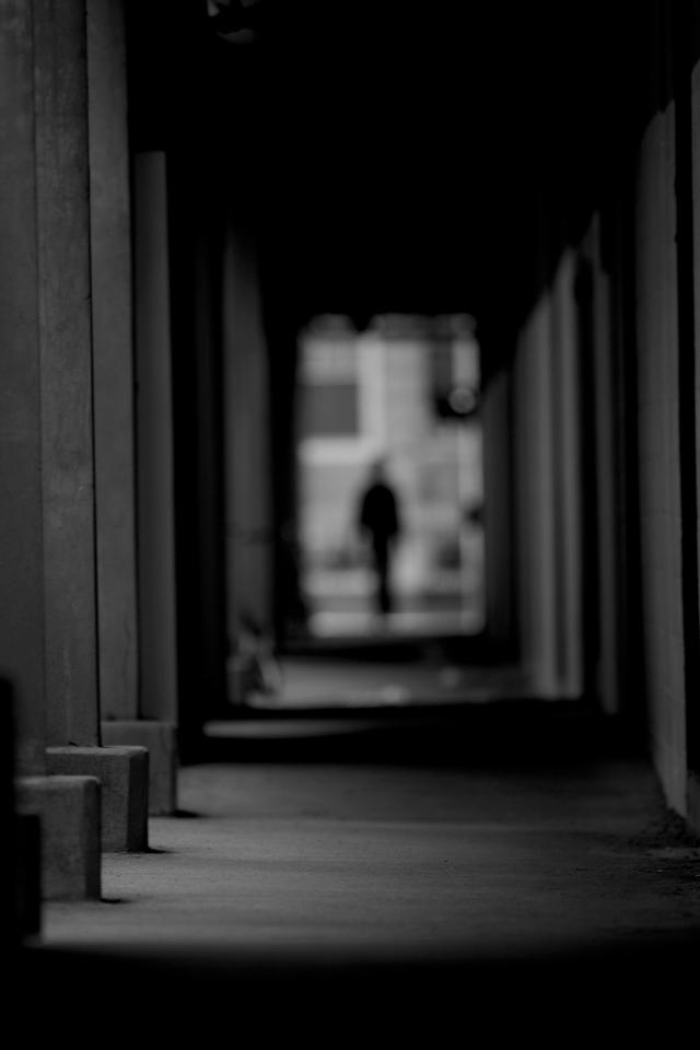 A man looks down a long, dusty hall. Photo by: Conrad Golovac