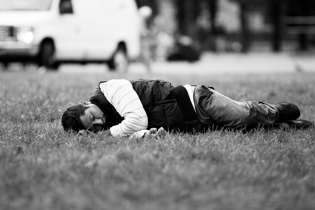 Photo by: Sam Sarkisian - JO 410 - A Latino man napping in the green of Copley.