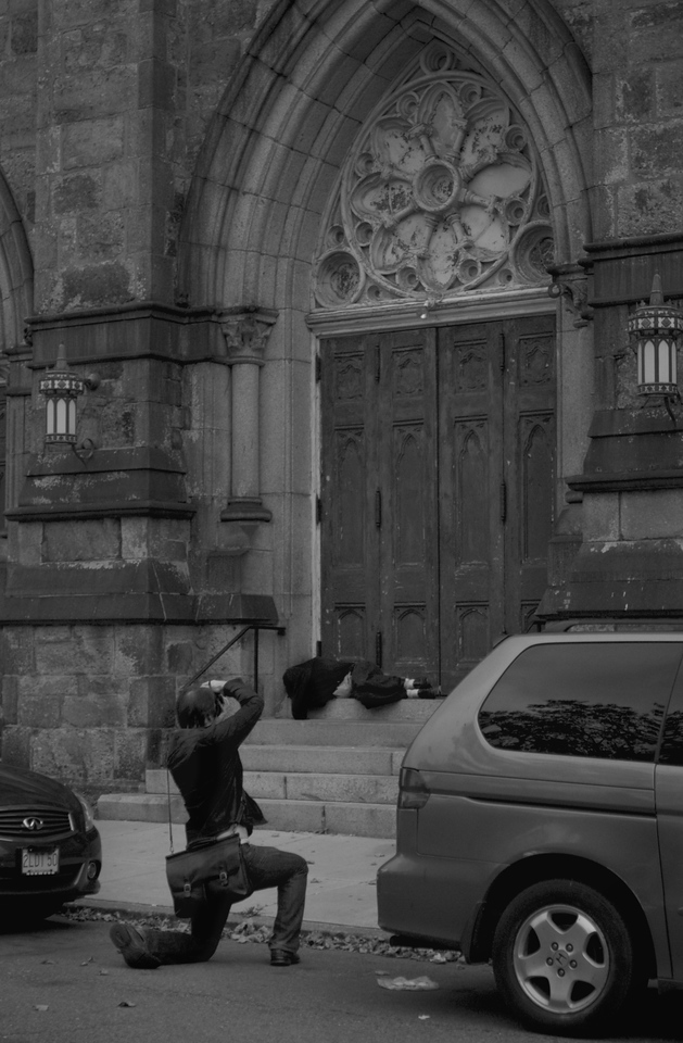 Phtographer John Sanderson captures poverty of Boston, with a homeless guy in front of a church. Boston, MA<br /> Photo by: Yongmyung Yi