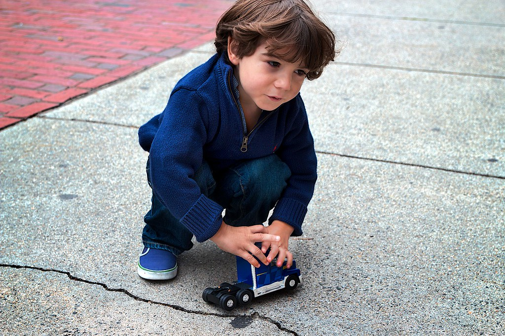 October 9th, 2012, Photograph of Hux playing with his favorite toy in the South End of Boston, MA.